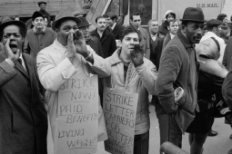 Postal strike 1970, men standing front of a mail truck