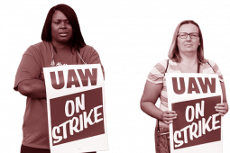 Two UAW workers with picket signs