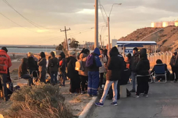 Chubut workers gathering by the side of the road.