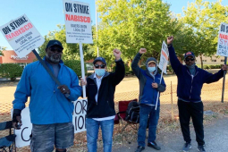 Several Nabisco picketers with signs outside in Portland, Oregon.