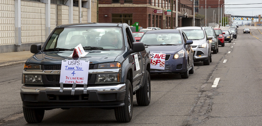 caravan of cars to support USPS in Detroit