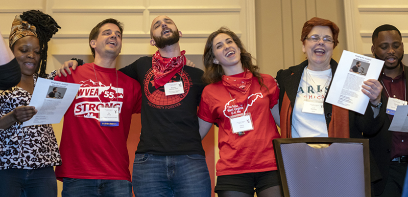Group of singers in line, with arms around each other, at 2018 Labor Notes Conference.
