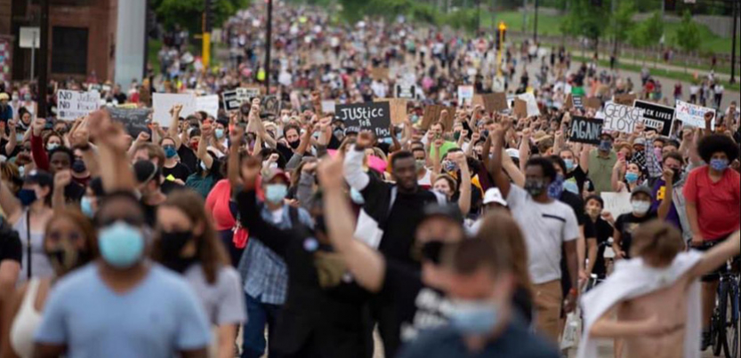 Crowd of protesters protesting George Floyd murder