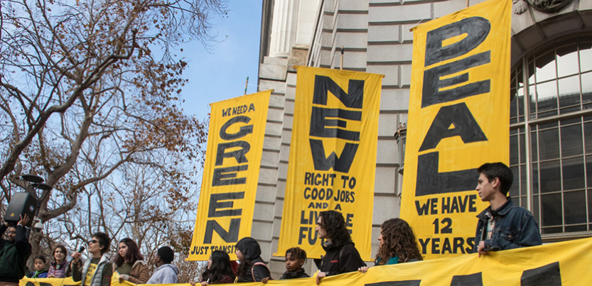 Green New Deal banners at rally