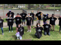 Duke University Press Workers Union posing in matching black T-shirts on grass.