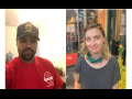 Luis wears a red RWDSU T-shirt and black Teamsters hat. Sarah wears a shirt with no text.