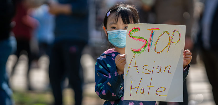 """Little girl holding sign reading """"Stop Asian Hate."""""""