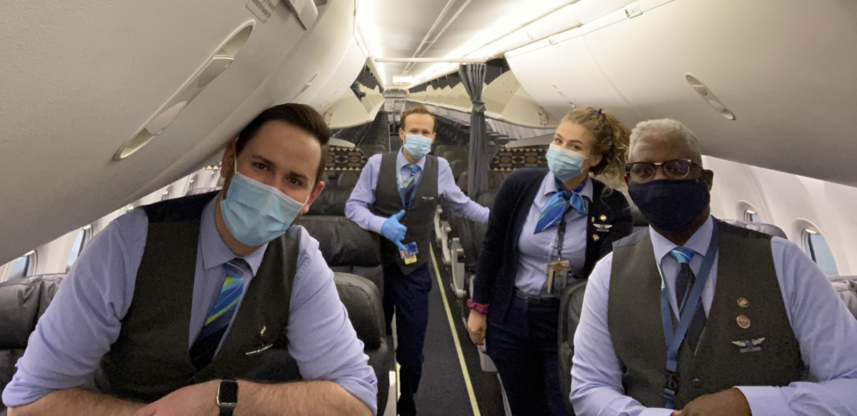 Four Association of Flight Attendants members wear masks on an Alaska Airlines flight.