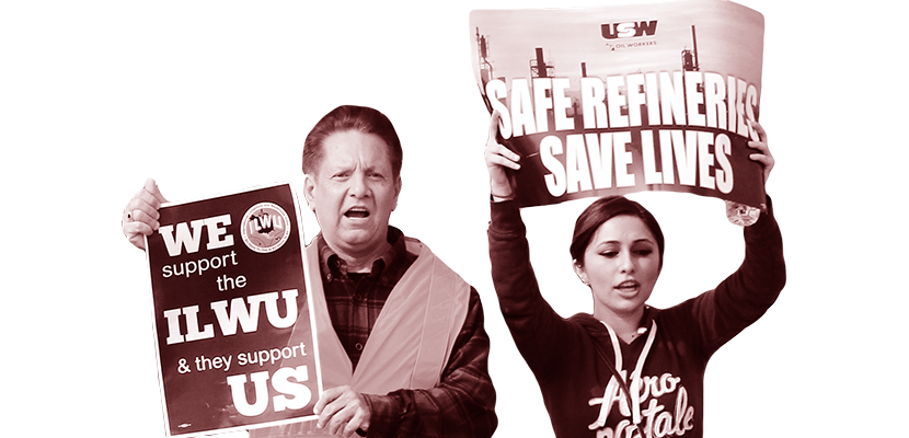 Two workers holding up signs.