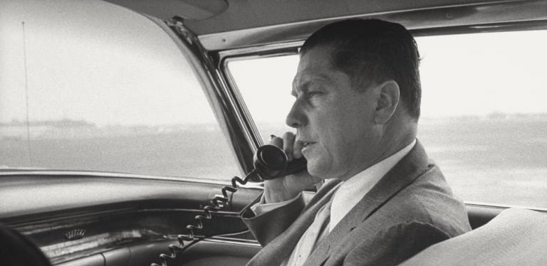 The late Teamsters president Jimmy Hoffa talking on the phone in a car.