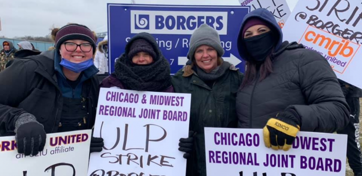 """Workers carry signs reading """"Chicago & Midwest Regional Joint Board, Workers United, ULP strike."""" Behind them is """"Borgers"""" sign."""