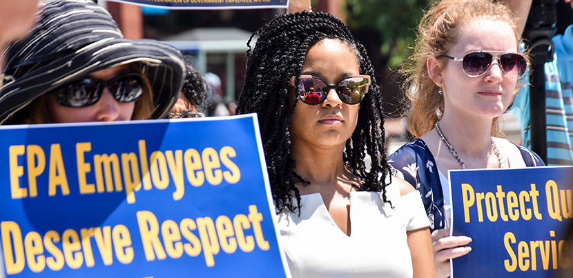 Three EPA workers protesting with signs: EPA workers demand respect. Other sign cut off.