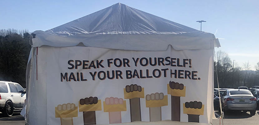 An Amazon-sponsored voting tent for workers during the Amazon Bessemer warehouse election.