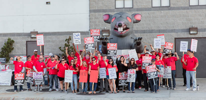 Dozens of Frontier workers / CWA members wearing red assembled with Scabby the inflatable rat
