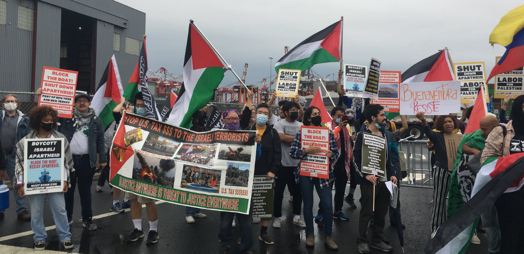 Block the Boat NY/NJ protesters with Palestinian flags at the port near Elizabeth, NJ.