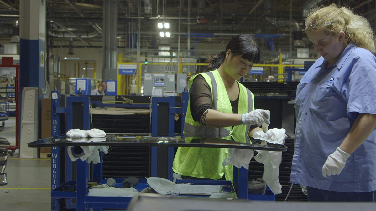 Two workers at work from the documentary American Factory