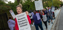 Chicago teachers and Service Employees (SEIU) Local 73 marching with signs.
