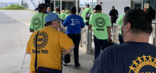 Workers in pro and con shirts before the UAW election at VW's plant in Chattanooga, Tennessee.