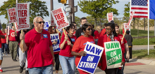 Crowd of GM workers on strike, marching.